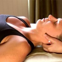 Massaging the neck for pain relief and relaxation
